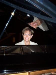 Jeanne VonDerAhe, Music Director, at her piano